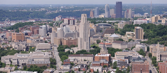 The Pittsburgh campus in Oakland with the Pittsburgh skyline in the background.